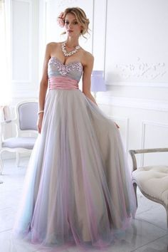 Sparkletini 3842 Jeweled Tulle Ball Gown - Prom Dress. Complementary colors of sumptuous layers of tulle make up this dress, highlighted by a satin waist band and sparkling jewels along the neckline.