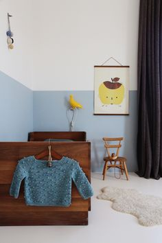 Tessa Hop's photo's are so serene and present some beautiful combinations of colors, materials and styles. Her house makes us want to re-do ours. /// half painted blue wall in kids room