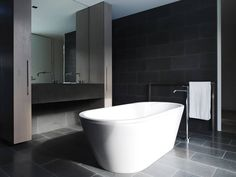 Natural Flat House Plans Made Naturally and Exotically: Attractive Bathroom View Of The A G House With White Tub Back Vanity Grey Floor And . Grey Bathrooms Designs, Bathroom Interior Design, Black Bathrooms, Kitchen Interior, Kitchen Design, Minimalist Bathroom, Modern Bathroom, Loft Bathroom, Interior Design Inspiration