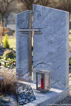 Einzelgrab in Granit mit eingesetztem Grabkreuz in Edelstahl