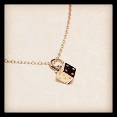 "Our 18kt ""Toss Your Luck"" Pendant necklace is available. Order yours today!"