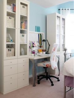 Home office, craft or sewing room idea.Gotta love all the storage in drawers and prettied up behind cabinet doors.