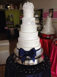 Elegant white and navy blue wedding cake by Exclusive Cake Shop- love the texture!