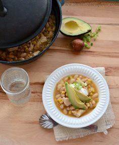 Quick, Easy, and Healthy White Chicken Enchilada Soup that practically makes itself. Chicken, beans, corn, and chilis together for a quick, easy, and healthy dinner.
