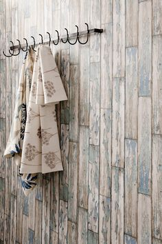 Peeling Planks - A natural wood paneling in a photo finish effect. Showing in mineral blue colouring