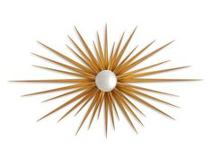 La luz de los espejos solCON RALLOS Este impresionante modelo brilla por la longitud de sus rayos, que alcanza los 136 cm.Es el espejo Lueur Espoir, de Christopher Guy, acabado en dorado envejecido (881€).