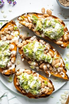 Stuffed Sweet Potatoes with White Bean and Guacamole. Healthy vegan comfort food… Stuffed Sweet Potatoes with White Bean and Guacamole. Healthy vegan comfort food, gluten-free and easy. Delicious as a main dish or side dish. Sweet Potato Recipes, Veggie Recipes, Whole Food Recipes, Vegetarian Recipes, Healthy Recipes, Vegan Stuffed Sweet Potato, Healthy Dishes, Recipes With Guacamole, Vegan Baked Potato