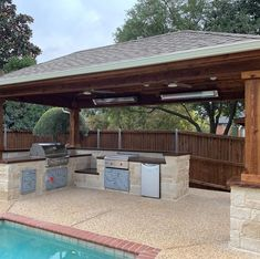 outdoor kitchen with covered patio Landscaping Company, Landscaping Ideas, Flower Bed Edging, Patio Grill, Deck Makeover, Drainage Solutions, Landscape Services, Stained Concrete, Outdoor Living Areas