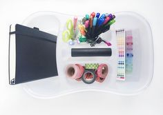 Create a supply caddy for all of your bullet journal supplies! There is a perfect place for every essential.. washi, pens, and the notebook!