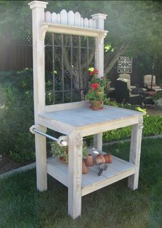 Potting bench with decorative iron insert ~ from The Old Potting Bench on Etsy $450.