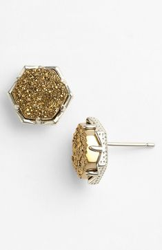 These shiny gold and bronze stud earrings are definitely eye-catching.