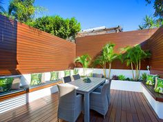 Deck with all round bench seating and fully fenced entertaining area and landscaping. PRIVACY plus! Timber Panelling, Timber Deck, Fence, Pergola, Real Estate, Outdoor Structures, Patio, Entertaining, Courtyards