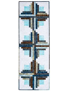 This easy design features a fun take on Log Cabin blocks to dress up your table. It's a fat quarter-friendly design that's simple to finish in no time. Made using just 8 fat quarters plus a 1/2 yard of background fabric. Sample was made using Jupiter...
