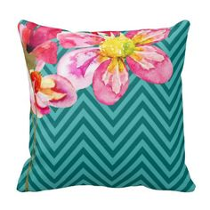 """This summery """"Chevron Floral"""" throw pillow features handpainted multi-colored flowers against a teal and turquoise chevron pattern. So stylish, it's suitable for any décor.  For questions or custom requests for matching products, please contact cheryl@cheryldanielsart.com. Available in 8 colors: coral, mauve, teal, celery, grey, black & white, yellow and taupe.  """"Chevron Floral"""" original design by Cheryl Daniels © 2014."""