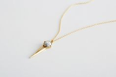 <p>Feel like your look could use a little direction? Let this swingy, arrow-shaped pendant show you the way. Anchored by a creamy, round howlite stone set in brass, it's up for just about any adventure—and that's the point.</p>