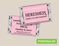 This personalized MINI candy wrapper showcases the news HERESHEIS decked out in pale pink for your baby girl. Since 1993 the iconic HERSHEY'S chocolate birth announcement has been winning over new parents, their families and friends. When you personalize the candy wrapper with her vital statistics, you'll be announcing your baby girl in style. Share your daughter's name and birth weight on front and choose your favorite back option for all added details.