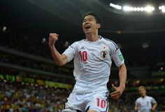 ca4ce837f7 Shinji Kagawa celebrates after scoring the second for Japan Shinji Kagawa