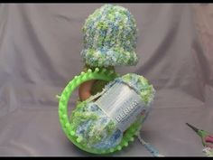Learn how to loom knit but also complete a baby's hat. Easy to follow with simple directions. Once you get used to the process, you can whip up a baby's hat in about 45 minutes. These projects make for excellent charitable items and are great for hospital wards. Find more about the yarn here: http://astore.amazon.com/thecr0ea-20?_encoding=UTF8.