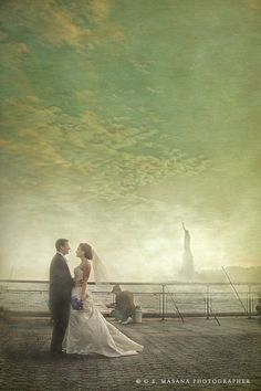 A quintessential view of the Statue of Liberty from Battery Park, NYC at a wedding.