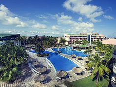 Book a vacation package at Hotel Playa de Oro in Varadero, Cuba. Varadero, Cuba Beaches, Station Balnéaire, Vacation Packages, Solo Travel, Swimming Pools, Mansions, House Styles, Outdoor Decor