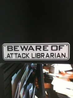 Beware of Attack Librarian sign - Proudly displayed by one of the Mississippi Library Commission's librarians. Don't worry--we only let her attack a little.