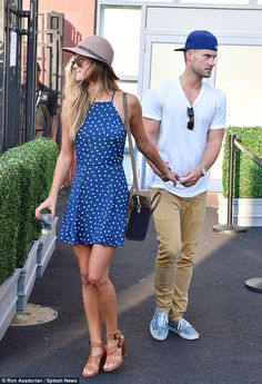 Loved up: Nina Agdal and her boyfriend Reid Heidenry attend the 2014 US Open on Friday...