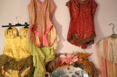 wall of costumes.   Sarah Sophie Flicker's wall.. love me some historic costumes!