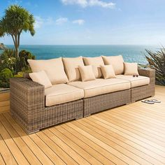 Luxury outdoor garden 4 seater sofa/settee mocha rattan/beige cushions. Truly stunning in design, this large 3 seater sofa gives a super high-class feel. This set consists of left and right hand end pieces, large middle sofa piece, clips to hold them together, 3 x scatter cushions and a heavy-duty cover in green. Made from fully weatherproof PE rattan, hand woven over a rust resistant frame. Call 02476 642139 or email sales@quatropi.com or visit www.quatropi.com for additional information.