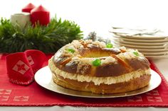 roscon de reyes =  sort of sweet brioche filled with whipped cream and topped with sweet dry fruits and sugar