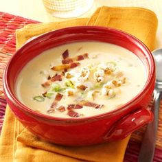 """Slow-Cooked Savory Cheese Soup Recipe from Taste of Home -- """"Let guests serve themselves and choose from fun garnishes such as popcorn, croutons, green onions and bacon bits,"""" recommends Ann Huseby of Lakeville, Minnesota."""