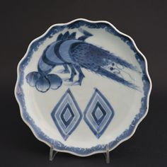 A Small 19th Century Japanese Blue and White Porcelain Dish, Arita Kilns, Probably Shida kiln, c.1820-1840. Decorated with a Spiny Lobster and Stylised Two Rice Boxes. The Border and the Rice Boxes have Sumihajiki Decoration. The Front of the Dish was Prepared with a White Slip Prior to Painting, that Hid the Rather Inferior Quality Body.