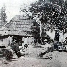 Maidu men playing a hand game - circa 1900