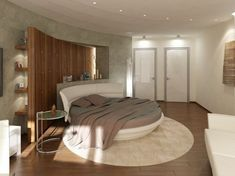 A wooden wall behind the circle bed brings a different textural element