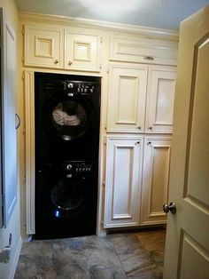 Laundry room features HE Full Capacity Gas Dryer and HE  Full Capacity Washer with built in cabinets for storage.  Built in Closet on opposite wall with broom/mop closet area and built-in ironing board. Spacious storage space!
