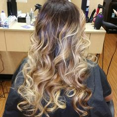 Ombre/balayage color. Dark shadow root with blonde and caramel balayaged through out. Love it!