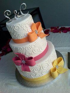 White Cake with orange pink & yellow bows