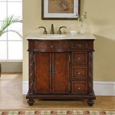 UVSR0213L36 A brown burl finish provides a rich texture for this hardwood cabinet. Your…