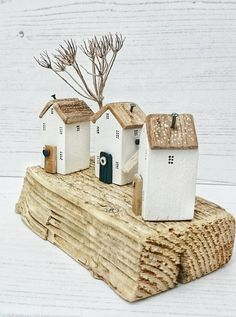 NEIGHBOURS IN WINTER Original artwork by DriftwoodSails Lovingly handcrafted wood sculpture, created using salvaged wood, natural weathered driftwood, chalk paint, nails, dried wildflowers from the Kent coast. Snow Scene of three little whitewashed wooden houses with driftwood