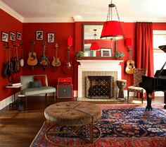 Music room with wall mounted guitars. Here's the same idea again! obsession?