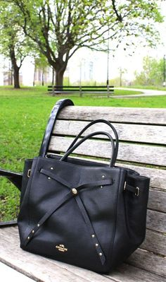 The new must have tote by Coach has a Turnlock Tie detail that is to die for! In refined black leather. #Ad