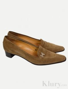 Hermes Suede Loafers Classic loafer with silver H buckle detail on tongue.  $249