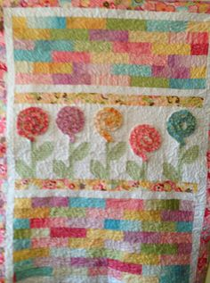 Jelly roll flowers baby quilt