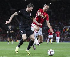 Ibrahimovic (right) is tackled by Mikhail Sivakov, who then feels the force of the 34-year...
