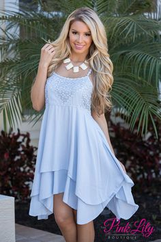 How adorable is this new dress?! Light blue, spaghetti strap dress with a lighter blue detail around the top and on the straps and a longer lining underneath!