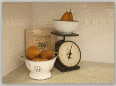 useful kitchen decor and love the white on white tile backsplash