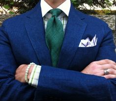 Green tie blue jacket