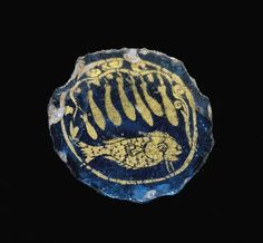 Roman gold glass medallion with fish and gourd vine, 3rd century A.D. Roundel consists of irregular circular border containing fish facing right beneath gourd vine with seven gourds, 2.2 cm diameter. Corning museum of glass