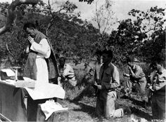 Men of the 38th Bomb Group attend a Catholic mass held on Christmas Day, 1942, in New Guinea.