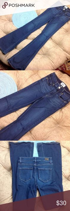Paige Jeans 25 High Rise Bell Canyon Dark Blue Great Condition Paige Jeans 25 High Rise Bell Canyon Dark Blue Distress Stretchy Flare 54/23/22/1 Rayon/Cotton/Poly/Spandex 34 inch inseam 9 inch rise 13 inch across waist Paige Jeans Jeans Flare & Wide Leg