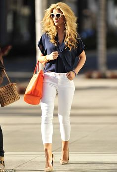 Need an orange bag!!!!! Glossy: Amy Willerton goes for an eighties look with big hair, blue blouse and white pedal pushers in Beverly Hills on Wednesday